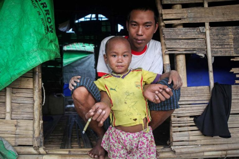 A Rakhine family shelters at Tain Myo IDP camp in Mrauk-U Township in September last year. Tens of thousands of Rakhine State residents have been displaced by conflict between the Arakan Army and Tatmadaw since December 2018. (Kyaw Lin Htoon | Frontier)
