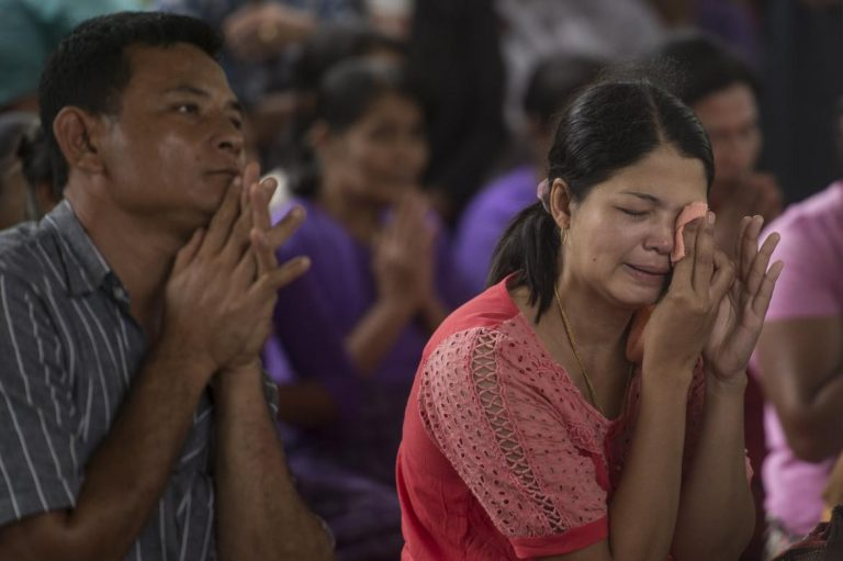 mass-funeral-held-for-victims-of-military-plane-crash-as-storm-slows-search-1582216876