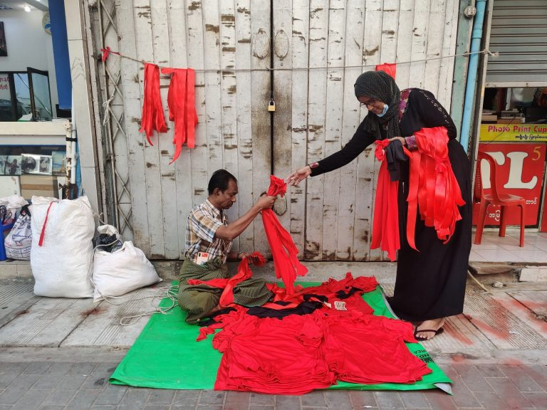 Some Yangon street vendors have shifted their wares from hats and purses to red ribbons and NLD flags to supply the growing protest movement.