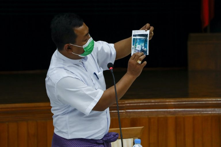 USDP candidate U Aung Myo Naing, who on November 8 lost the race for the Yangon Region Hluttaw seat of Hlegu-1, shows what he said is photographic evidence of the NLD committing voter fraud at a USDP press conference in Yangon on November 11. (Nyein Su Wai Kyaw Soe | Frontier)